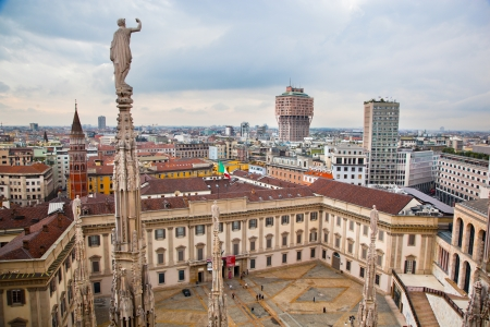 milano: Milan, Italy panorama. View from Milan Cathedral. Royal Palace of Milan - Palazzo Realle and Velasca Tower in the background