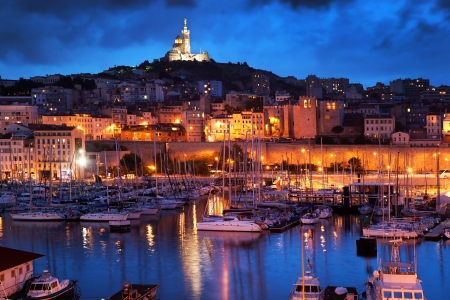 marseille: Marseille, France panorama at night. The famous european harbour view on the Notre Dame de la Garde Stock Photo
