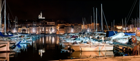 garde: Marseille, France panorama at night. The famous european harbour view on the Notre Dame de la Garde Stock Photo