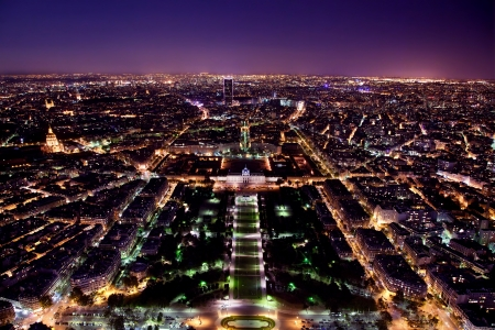 parisian scene: Paris panorama, France at night. View on Field of Mars and Montparnasse Tower from Eiffel Tower.