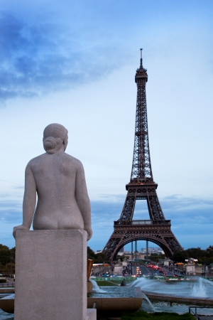 Eiffel Tower in Paris, Fance. Fountain and statue in Jardins du Trocadero photo