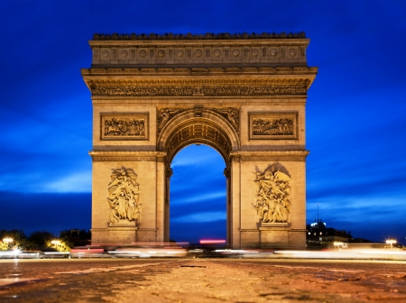 Arc de Triomphe, Paris, France at night. View from Avenue des Champs-Elysees photo