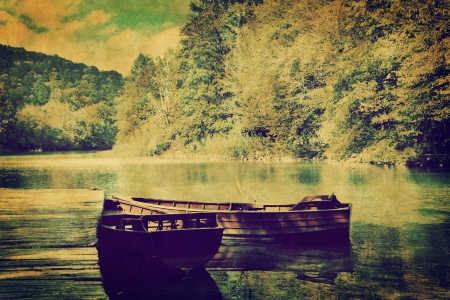 river stones: Lake and two boats in forest. Retro vintage romantic syle
