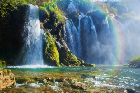 Waterfall in forest. Crystal clear water. Plitvice lakes, Croatia photo