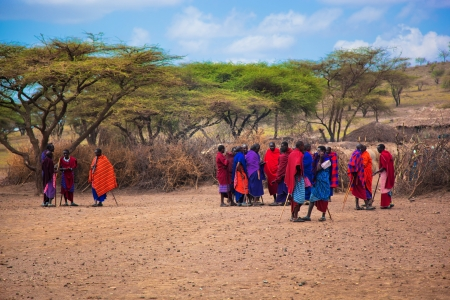 Maasai village, TANZANIA, AFRICA - DECEMBER 11: A group of Maasai people in traditional clothes in front of their village on December 11, 2012 in Tanzania. Maasai people are among the best known of African ethnic groups, due to their residence near the ma