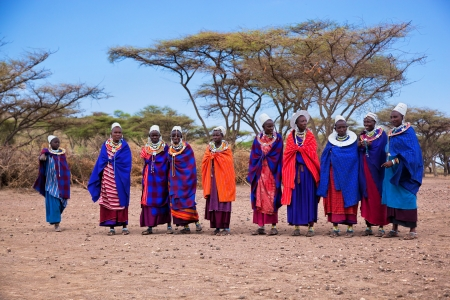 Maasai village, TANZANIA, AFRICA - DECEMBER 11: A group of Maasai women in traditional clothes in their village on December 11, 2012 in Tanzania. Maasai are one of the best known ethnic groups in Africa living in their traditional old way.