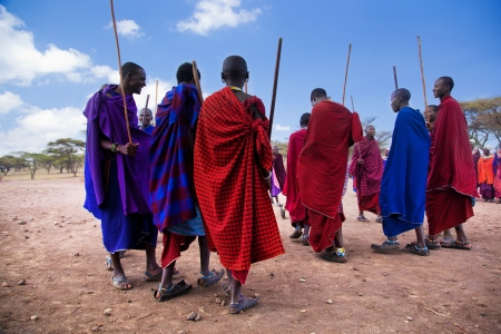 Maasai village, TANZANIA, AFRICA - DECEMBER 11: A group of Maasai men performing their ritual dance in traditional clothes in their village on December 11, 2012 in Tanzania. Maasai people are among the best known of African ethnic groups located in Kenya