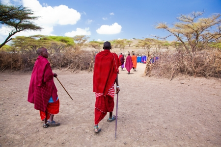 Maasai village, TANZANIA, AFRICA - DECEMBER 11: A group of Maasai people in traditional clothes in front of their village on December 11, 2012 in Tanzania. Maasai people are among the best known of African ethnic groups located in Kenya and northern Tanza