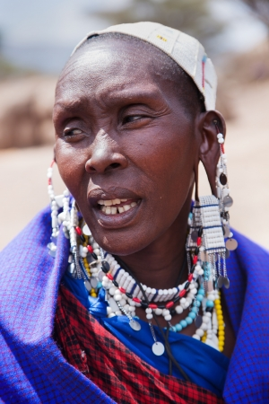 Maasai village, TANZANIA, AFRICA - DECEMBER 11: Maasai woman portrait in traditional clothes on December 11, 2012 in Ngorongoro Tanzania. Maasai people are among the best known of African ethnic groups located in Kenya and northern Tanzania.