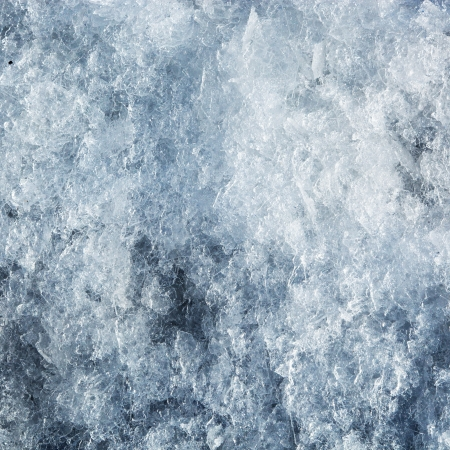 Ice frozen background. Cold blue tint photo