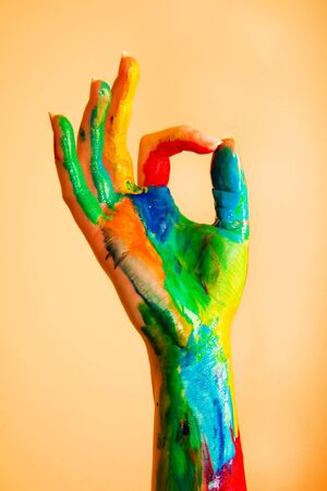 kids painted hands: Painted hand with OK sign, colorful fun. Creative, funny and artistic means happy!  Stock Photo