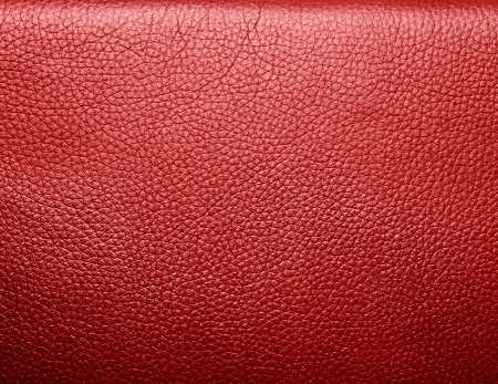 Soft wrinkled red leather. Texture or background with copyspace, high resolution photo