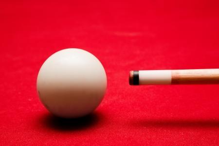 billiard balls: Billards pool game. Aiming at cue ball. Red cloth table