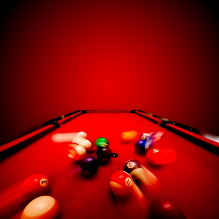 Billards pool game. Breaking the color ball from triangle. Red cloth table Stock Photo