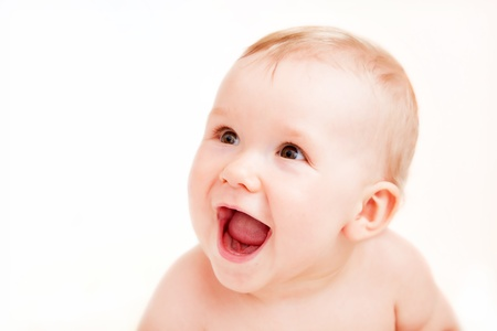 Cute happy baby laughing. Portrait of the boy on white background Stock Photo - 20336971