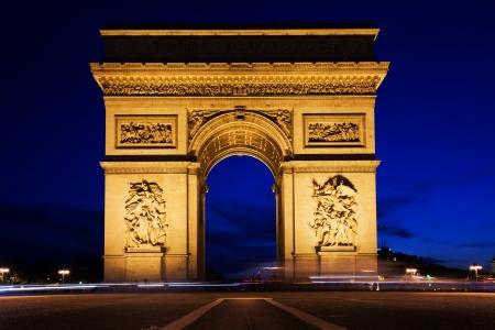 triumphe: Arc de Triomphe, Paris, France at night. View from Avenue des Champs-Elysees