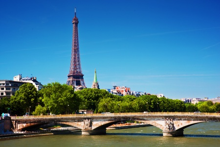 Eiffel Tower and bridge on Seine river in Paris, France. View from Alexandre Bridge at sunny day photo