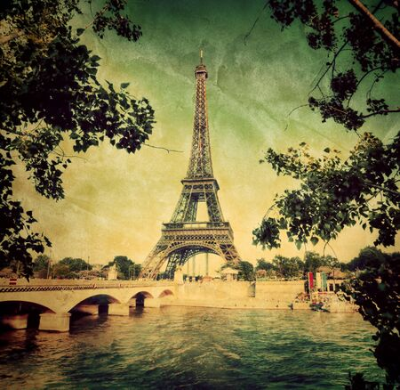 Eiffel Tower and bridge on Seine river in Paris, France  Vintage retro style photo