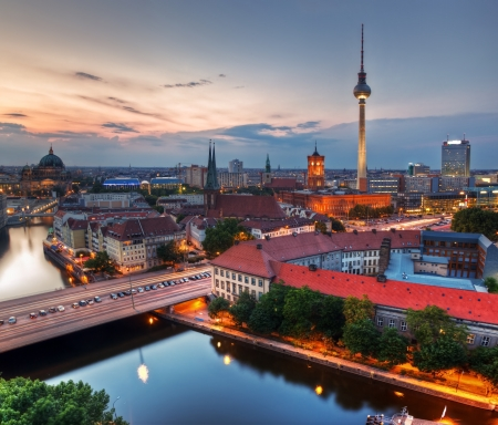 Berlin, Germany rooftop view on Television Tower, Berlin Cathedral, Rotes Rathau and the River Spree - the major landmarks at late sunset photo