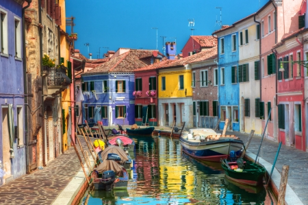 Colorful houses and canal on Burano island, near Venice, Italy. Sunny day. photo