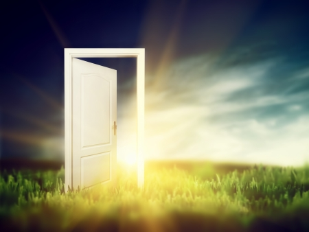 Open door on the green field. Conceptual new way, entrance to new world, heaven, life, hope. photo