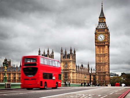 historical landmark: London, the UK. Red bus in motion and Big Ben, the Palace of Westminster. The icons of England in vintage, retro style Editorial