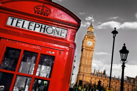 Red telephone booth and Big Ben in London, England, the UK. The symbols of London on black on white sky. photo