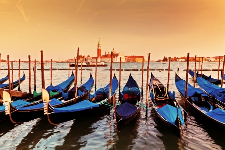 Venice, Italy. Gondolas on Grand Canal at sunset. San Giorgio Maggiore in the background photo