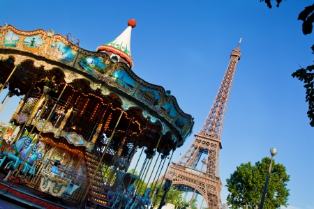 Eiffel Tower and vintage carousel at a sunny summer day, Paris, France