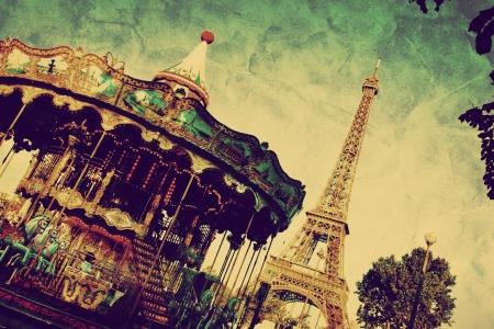 parisian: Eiffel Tower and vintage carousel, Paris, France. Retro style