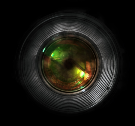 dslr camera: DSLR camera lens, front view, black background. Stock Photo