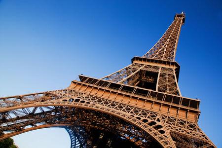 parisian: Eiffel Tower at wide angle. Blue sunny sky. Paris, France Stock Photo