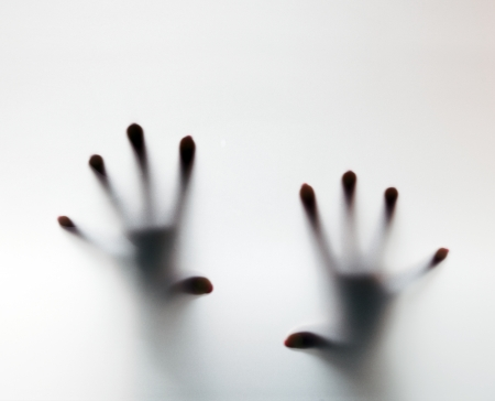 Hands touching frosted glass. Conceptual scream for help, depression, stress, panic Stock Photo