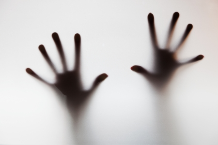 hysteria: Hands touching frosted glass. Conceptual scream for help, depression, stress, panic Stock Photo