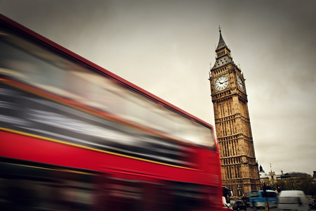 palace of westminster: London, the UK  Red bus in motion and Big Ben, the Palace of Westminster  The icons of England