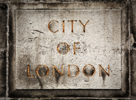 Old grunge stone board with golden City of London text photo