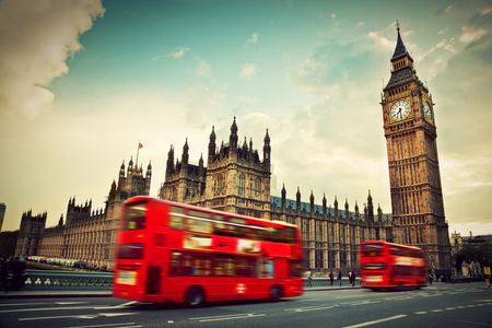 great britain: London, the UK. Red bus in motion and Big Ben, the Palace of Westminster. The icons of England in vintage, retro style Editorial