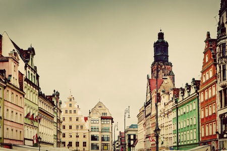 polska monument: Wroclaw, Poland. The market square with historical buildings and St. Elizabeths Church. Silesia region. Vintage, retro style