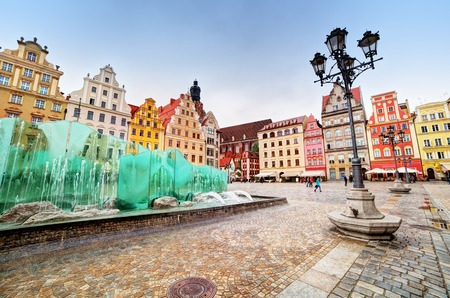 silesia: Wroclaw, Poland. The market square with the famous fountain and colorful historical buildings. Silesia region. Stock Photo