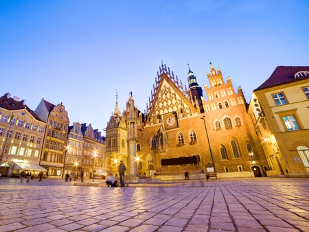 polska monument: Wroclaw, Poland. The historical Town Hall on market square at night. Silesia region.