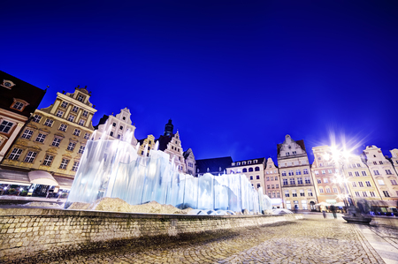 polska monument: Wroclaw, Poland. The market square and the famous fountain at night. Silesia region.