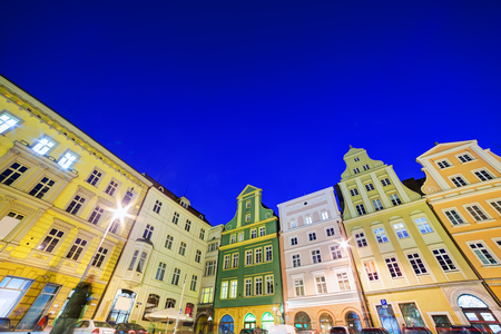 polska monument: Wroclaw, Poland. The market square with colorful historical buildings at night. Silesia region. Stock Photo