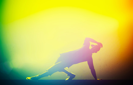 break in: Hip hop, break dance performed by young man in colorful club lights  Breakdance party time Stock Photo