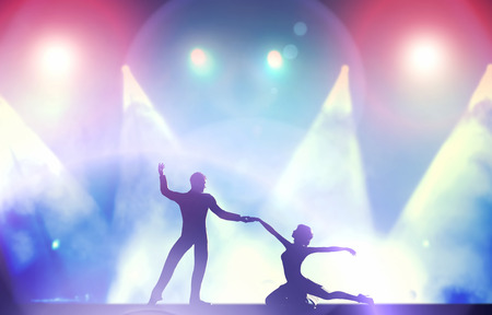 A couple of dancers in elegant, passionate dancing pose in club lights  Party, nightlife photo