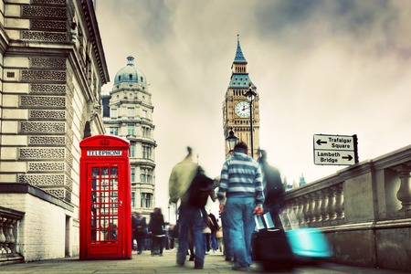 Red telephone booth and Big Ben in London, England, the UK  People walking in rush  The symbols of London in vintage, retro style