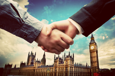 city of westminster: Business in London. Handshake on Big Ben, Westminster background. Deal, success, contract, cooperation concepts