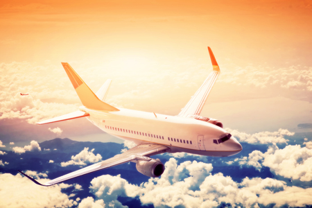 passenger aircraft: Airplane in flight. A big passenger or cargo aircraft, airline above clouds. Travel, transportation, transport, business in motion.