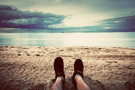 hairy legs: First person perspective of man legs on the autumn beach  Vintage, retro style Stock Photo