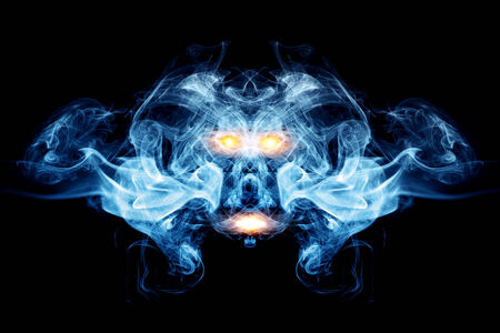 Abstract face made of smoke, flames  May be the concept of ghost, devil, logo element, background photo