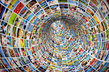 Tunnel of media, images, photographs  Tv, multimedia broadcast, streaming  All photos are mine  Concepts of television, adverstising, internet, entertainment  photo